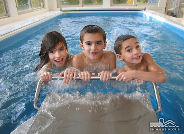 three kids playing in the Original Endless Pool