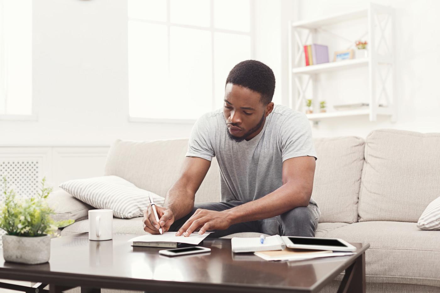 man arranging student debt papers