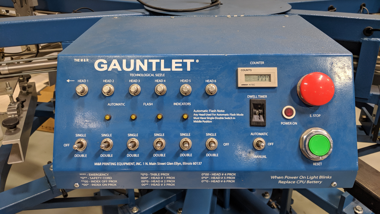 The control panel for an M&R Gauntlet screen printing press