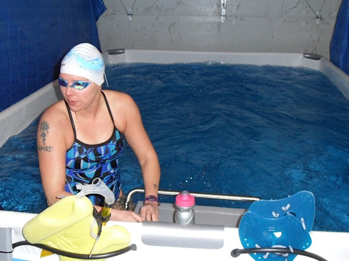 Open water swimmer Katie Benoit trains for her marathon swim events in the Endless Pool in her garage
