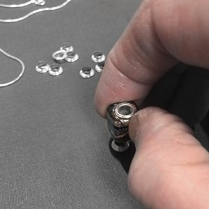 Attaching a grommet to a lampwork bead