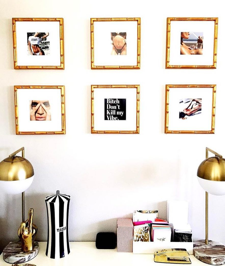 classic gold gallery wall above a desk