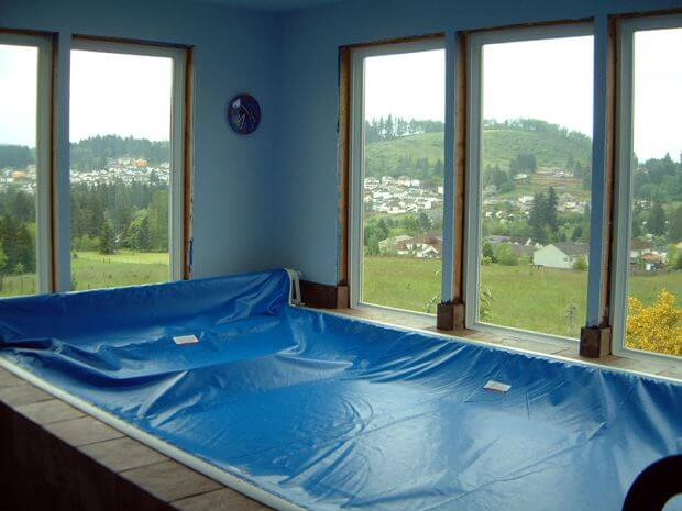 The indoor Endless Pools swimming machine in the Meals Family's sunroom