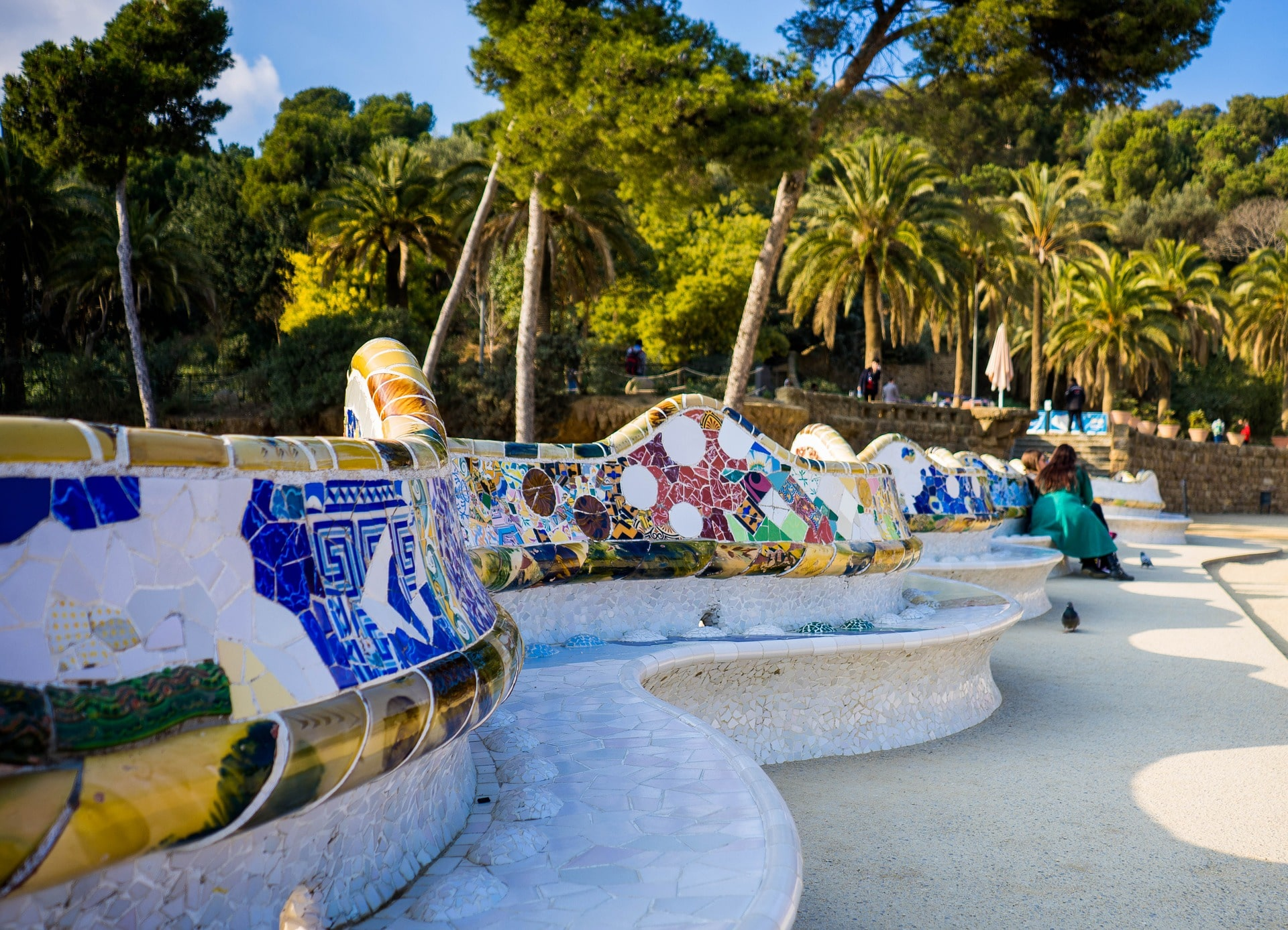 Marveling at the whimsical Park Guell is an incredible thing to do in Spain
