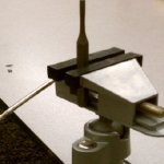 Using a vise to set a rivet with a bezel cup