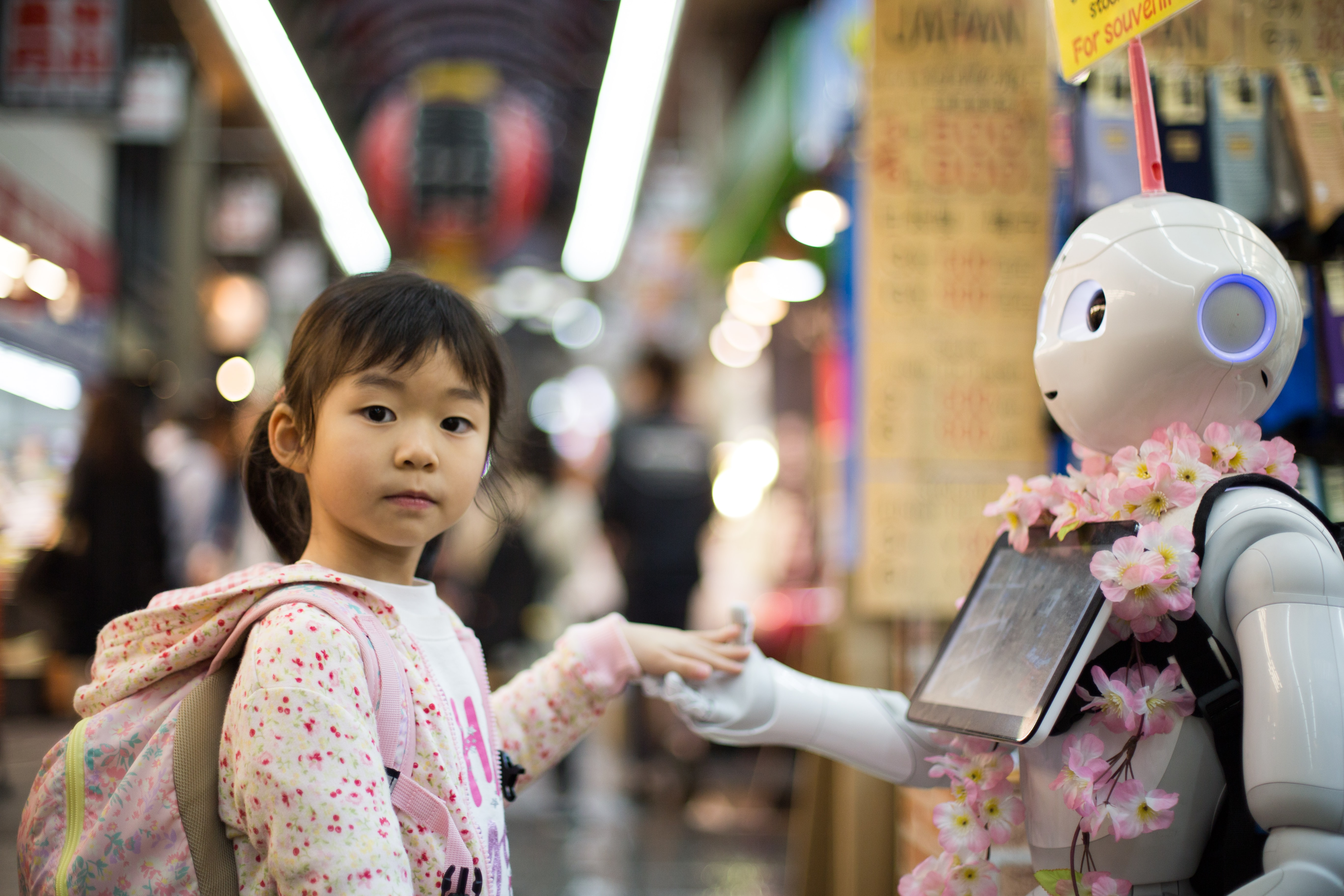 Little girl playing with robot in Japan
