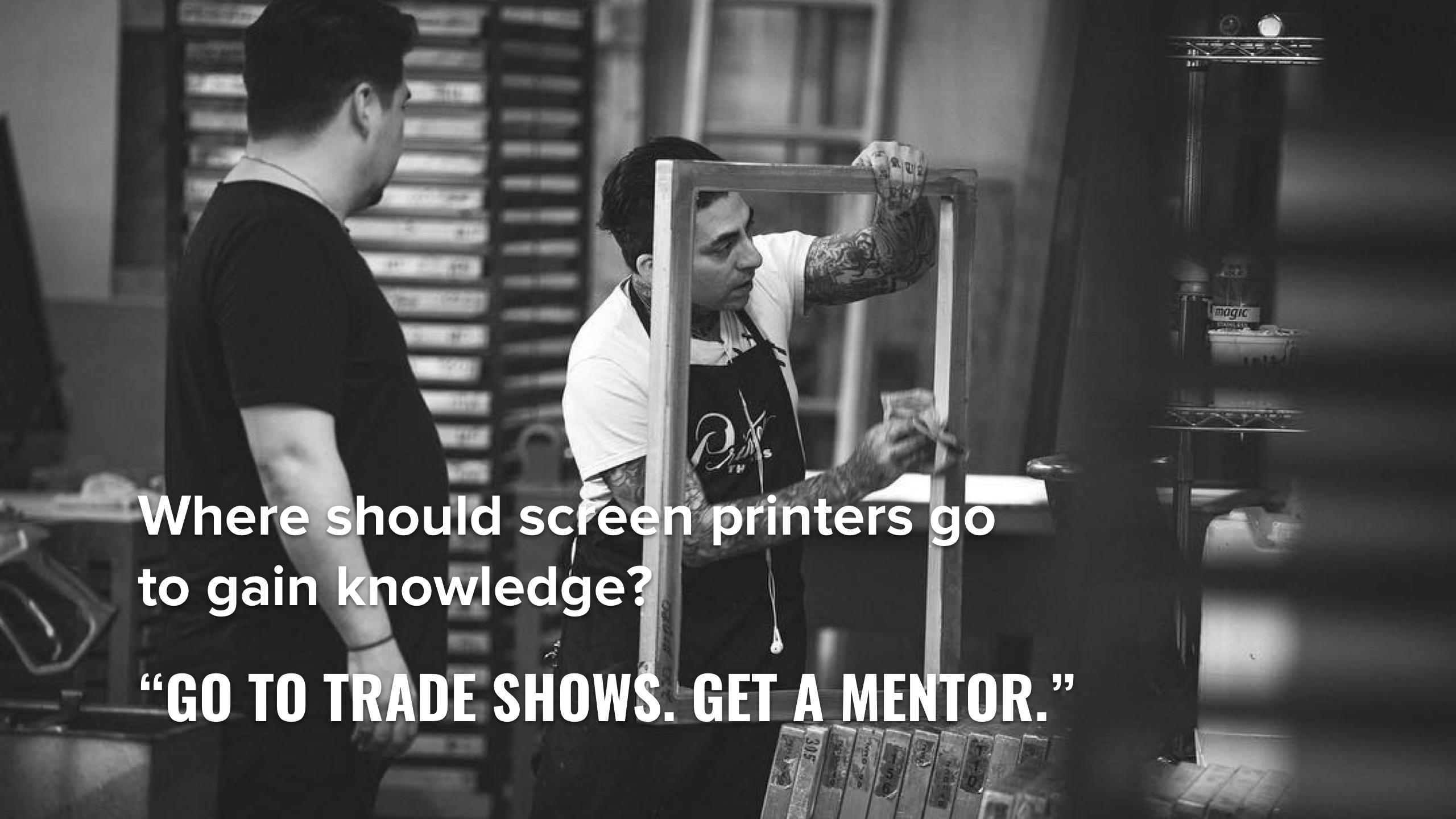 A screen technician checks a screen printing screen.