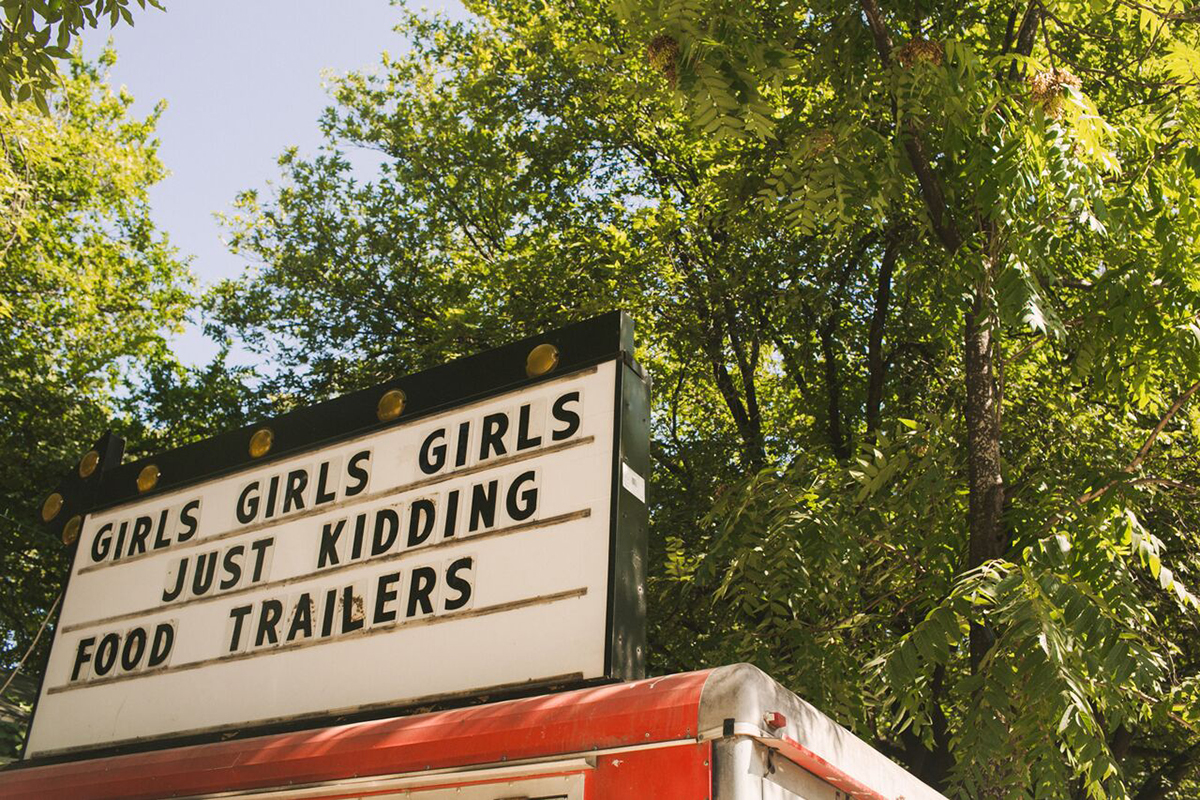 A sign advertises food trailers.