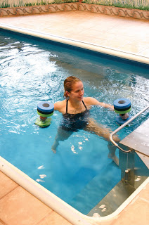 a woman performs aquatic exercise in the Endless Pool at nationally ranked Conshohocken Physical Therapy