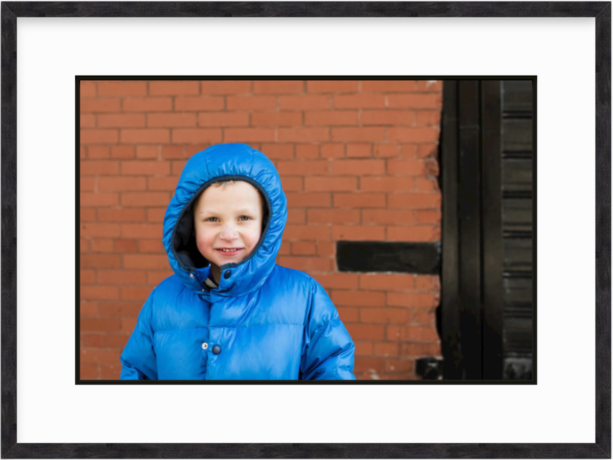 photo of boy in jacket in walnut wood frame
