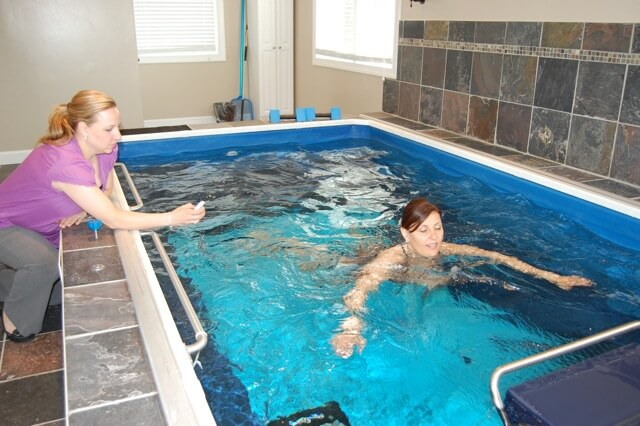 Physical Therapist with a PT client in the Commercial Endless Pool at Conshohocken Physical Therapy