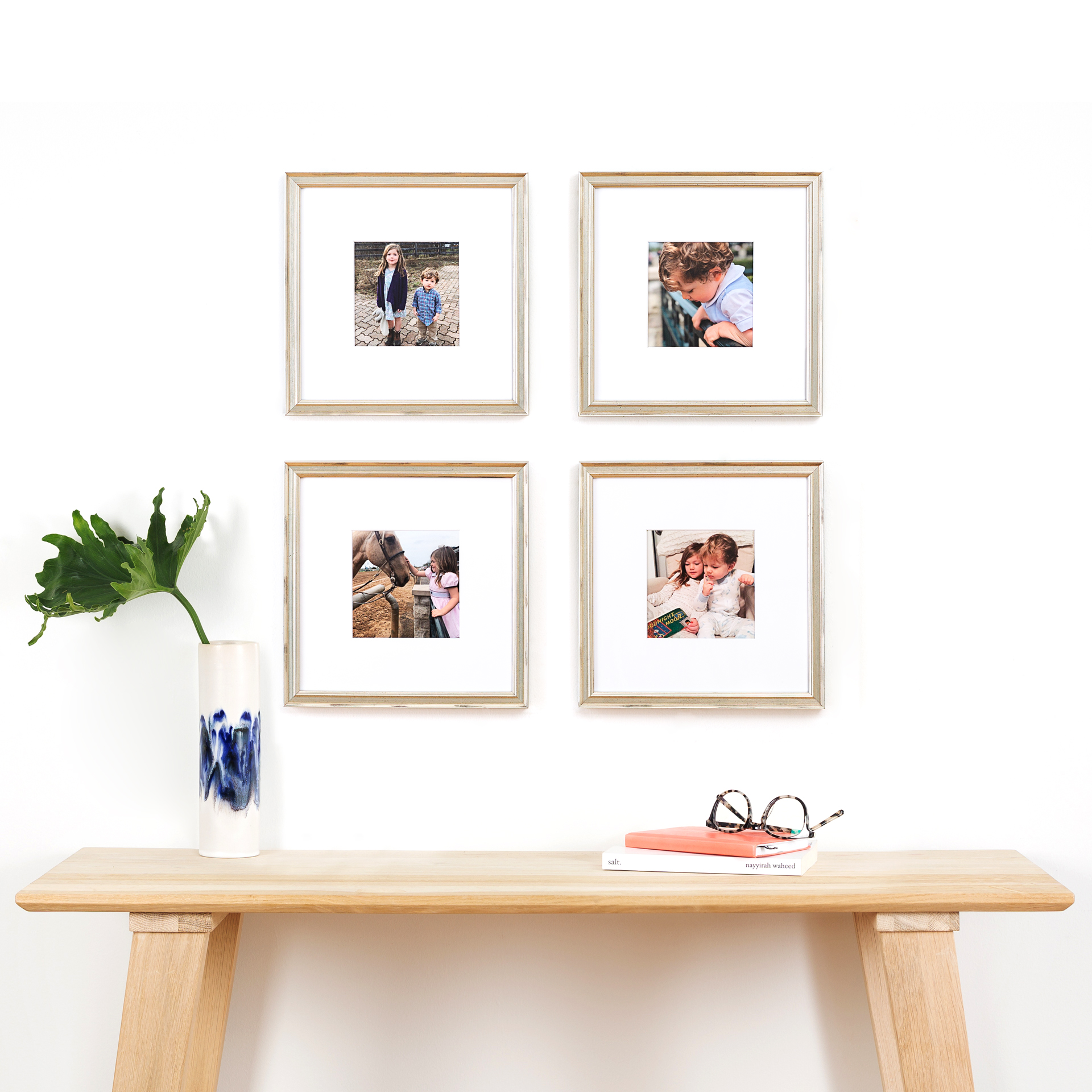 four picture frames above a table