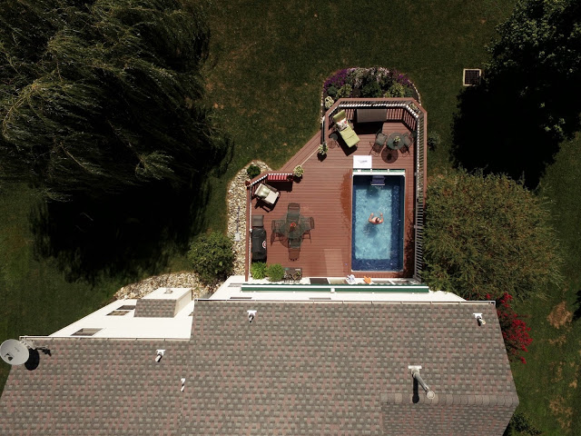 a drone photograph of an Endless Pools swimming machine installed on a backyard deck
