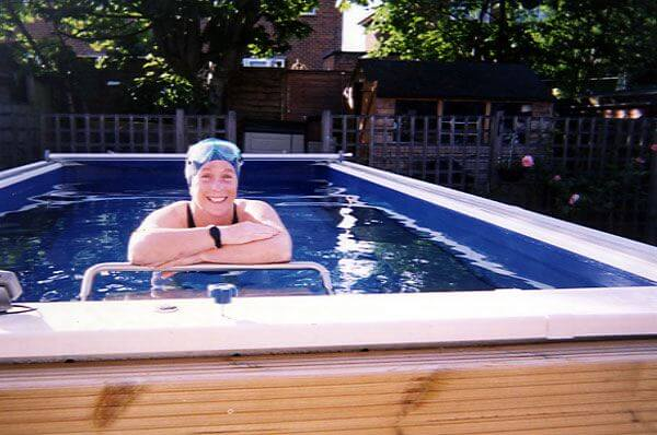 Marathon swimmer Julie Bradshaw in her garden Endless Pool