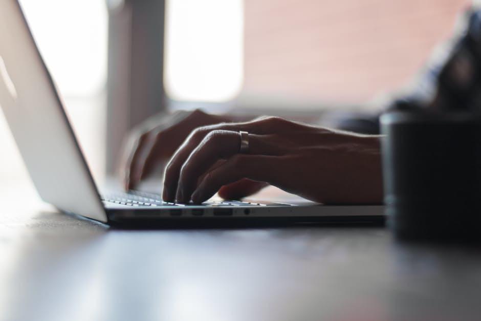 man writing financial blog