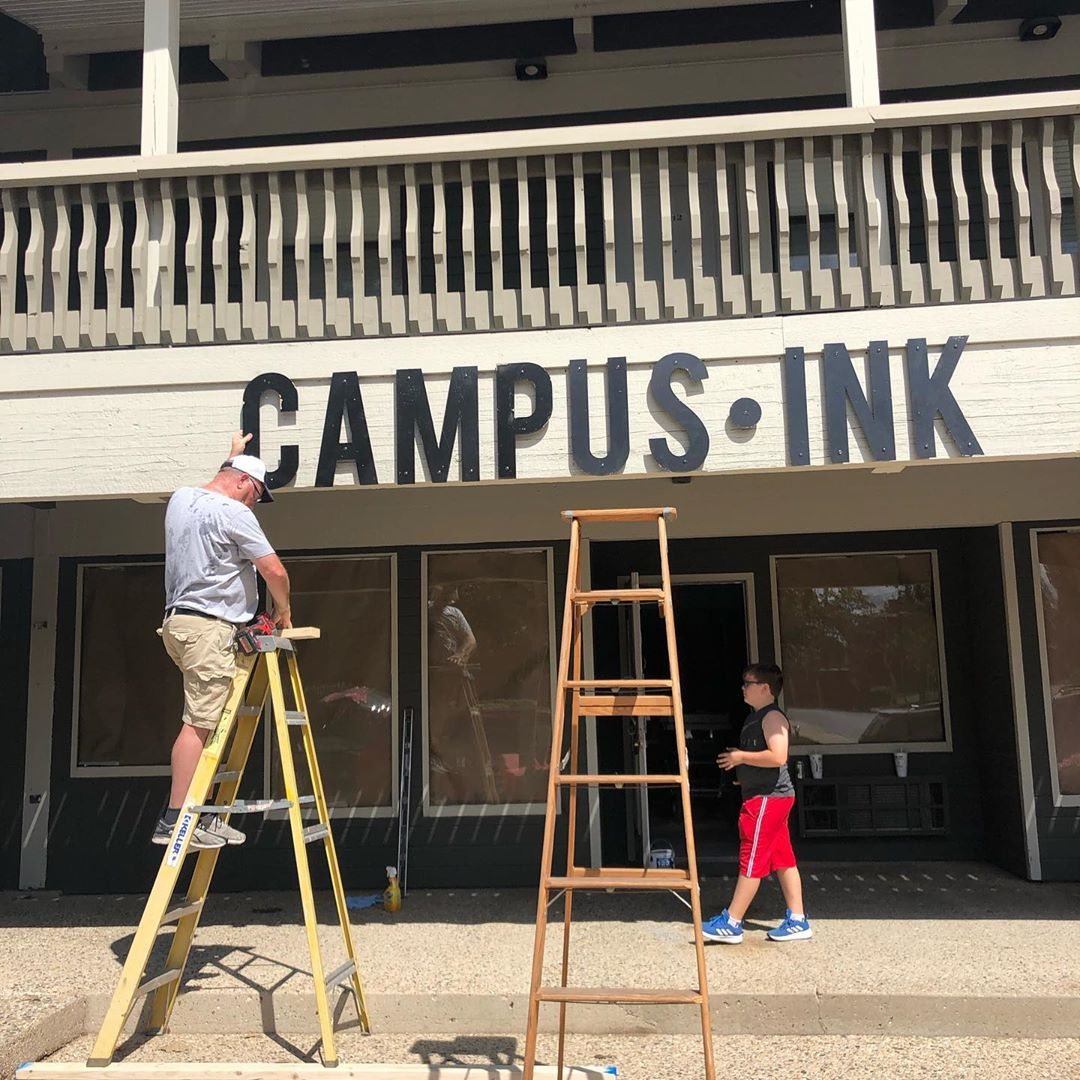 Jedd works on the Campus Ink sign.