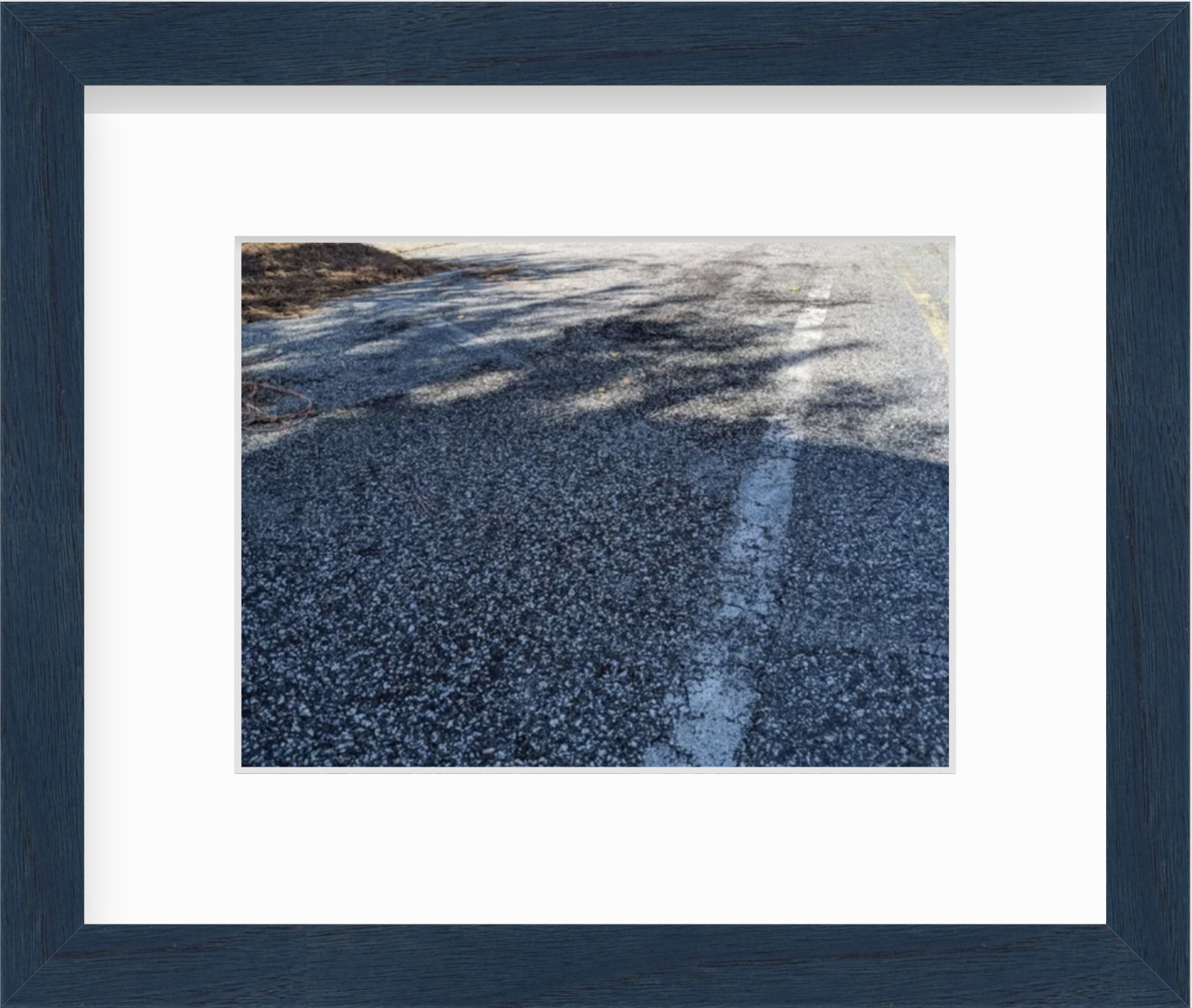 framed photo of road
