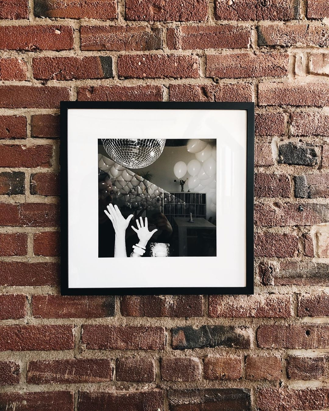 black frame on brick