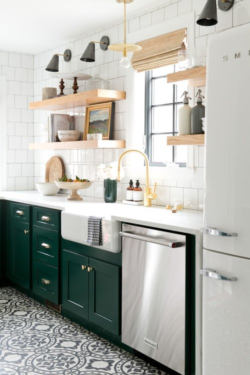 kitchen with green cabinets and gold frame