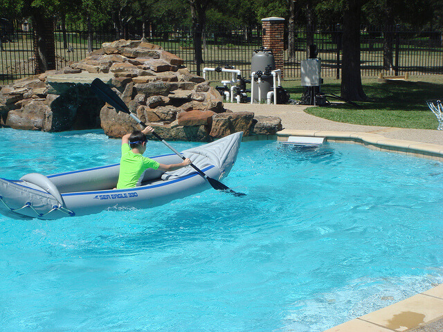 a kayaker paddles in place with the Endless Pools Fastlane current