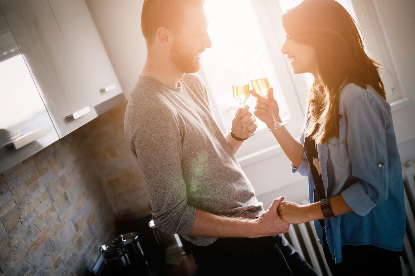 couple cheers champagne glasses