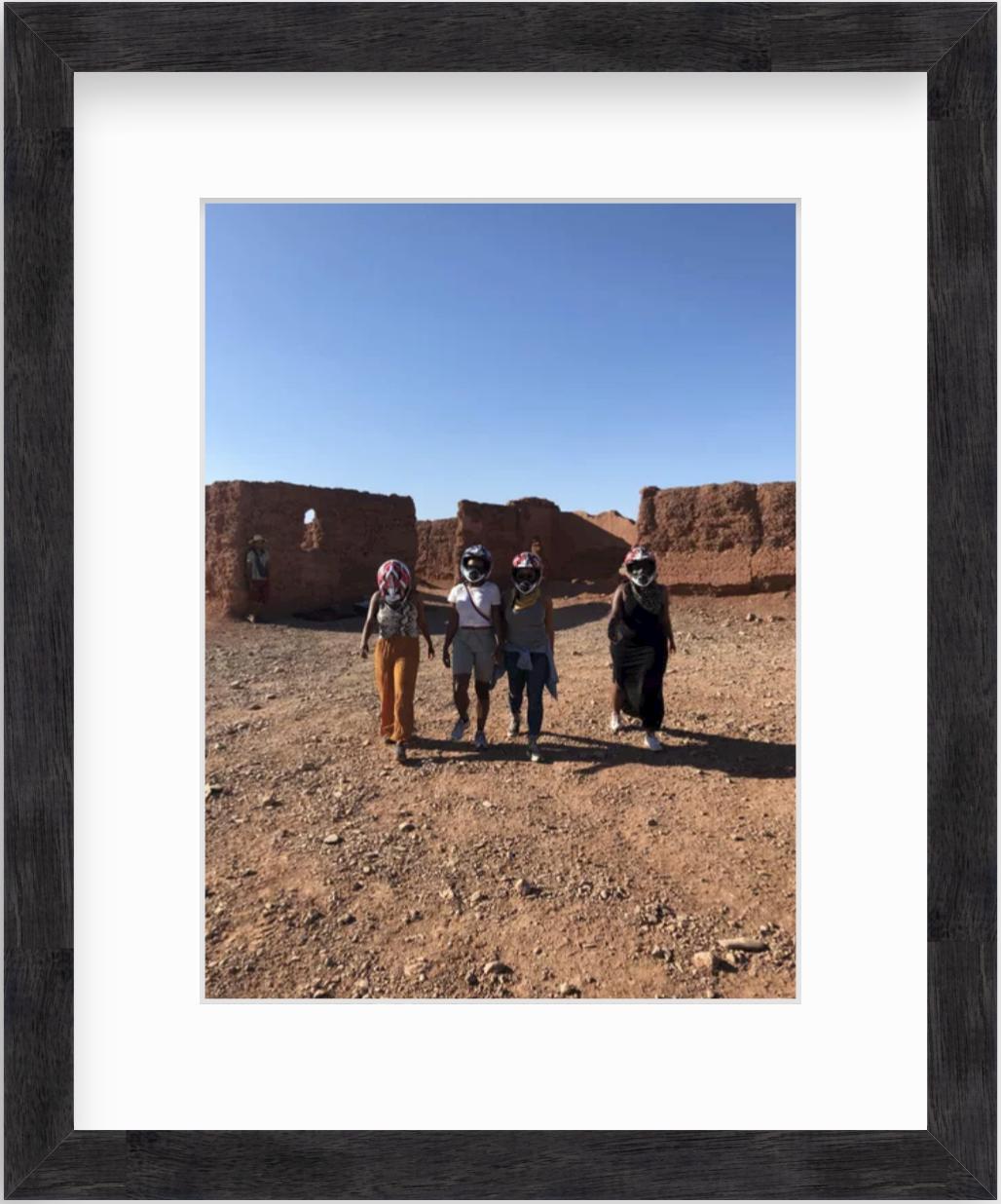 four women in desert in morocco