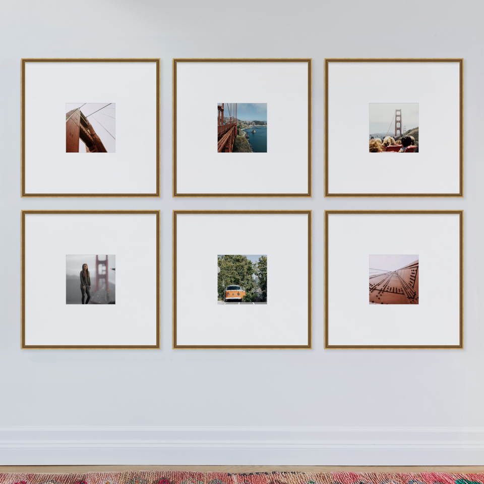 oversized grid gallery wall in gold frames