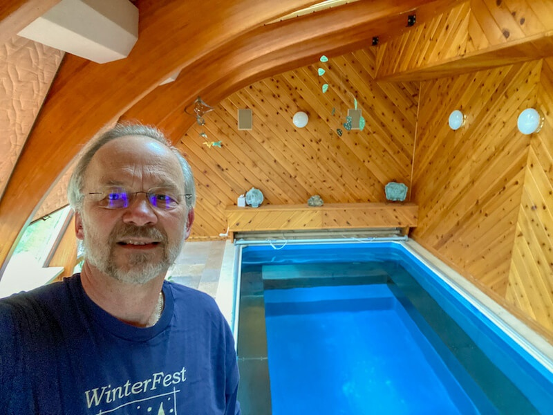 Jim with his Endless Pools Original model installed indoors in his Iowa home