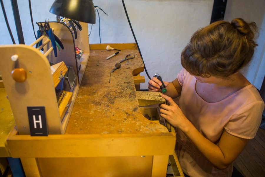 Woman working at a jeweler's bench