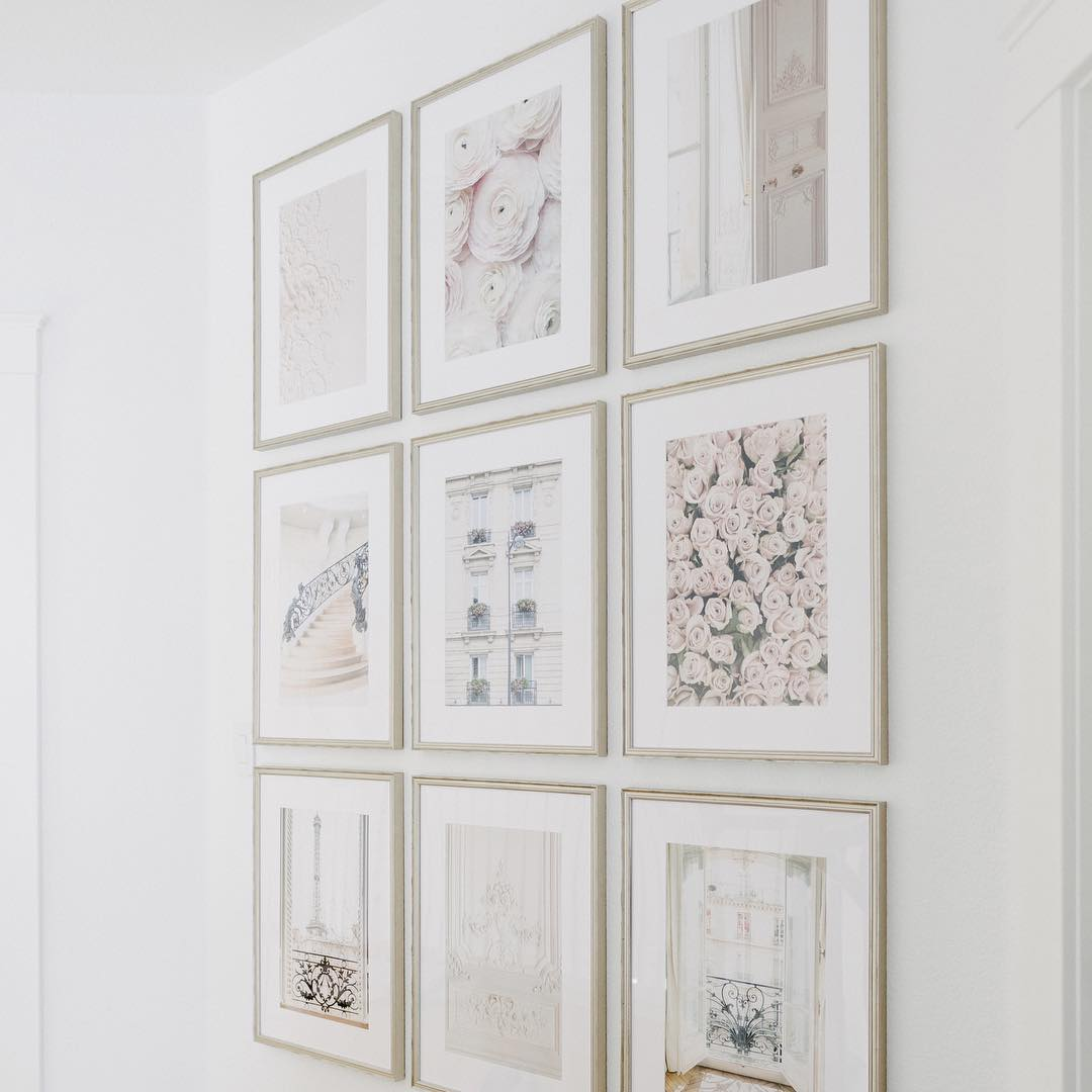 gallery wall of parisian prints in silver frames