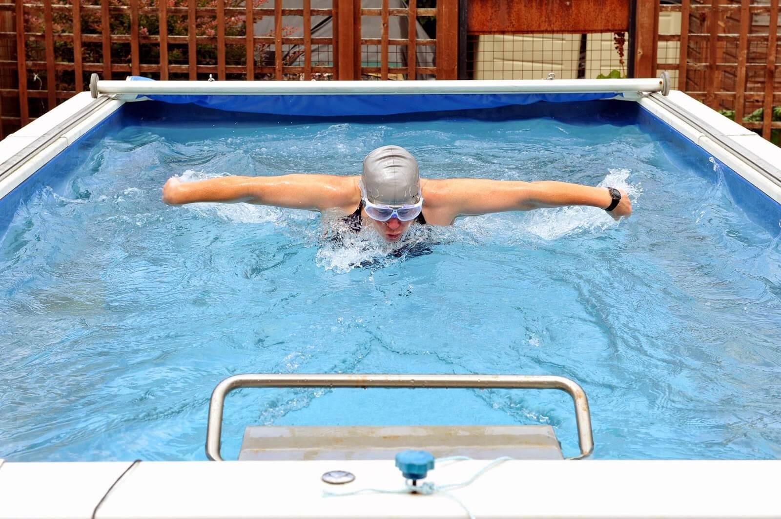 Open water swimmer Julie Bradshaw swimming butterfly in her Endless Pool