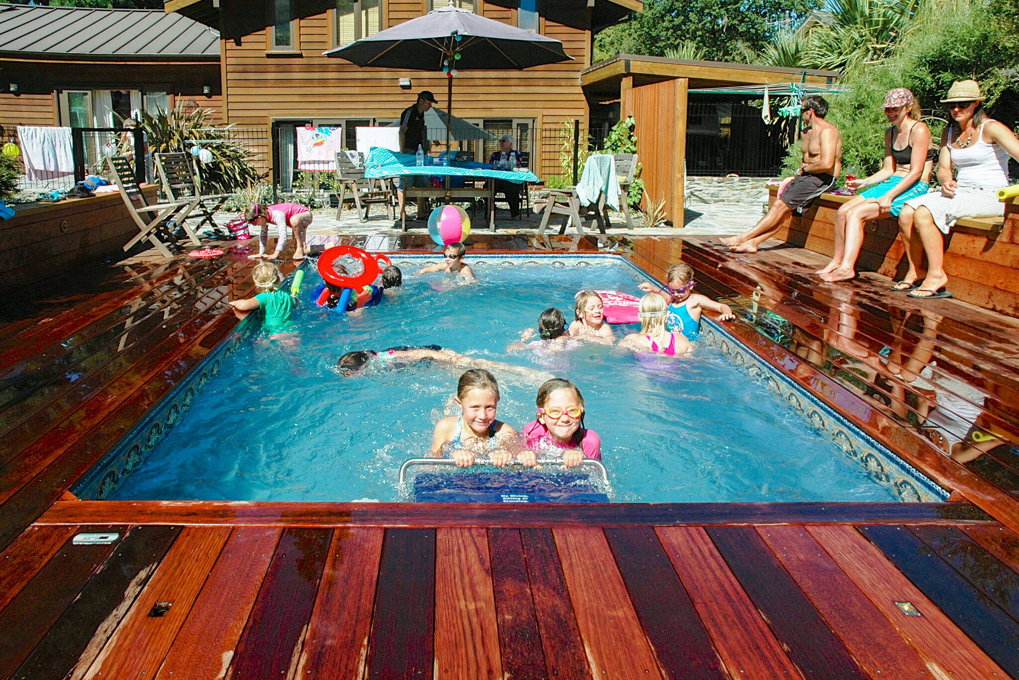 a fully inground Original Endless Pool used for a children's party
