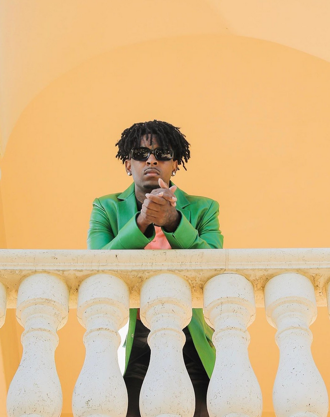 man in colorful suit on railing