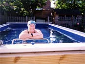 Open water swimmer Julie Bradshaw in the Endless Pools swimming machine in her garden