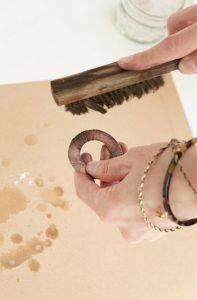 Burnishing a metal blank using a brass brush