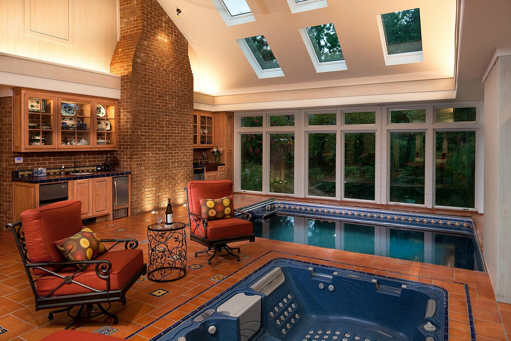 in-ground Original Endless Pools in an open kitchen with skylights