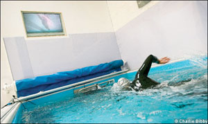 A swimmer tests the Endless Pools swim current for the Financial Times