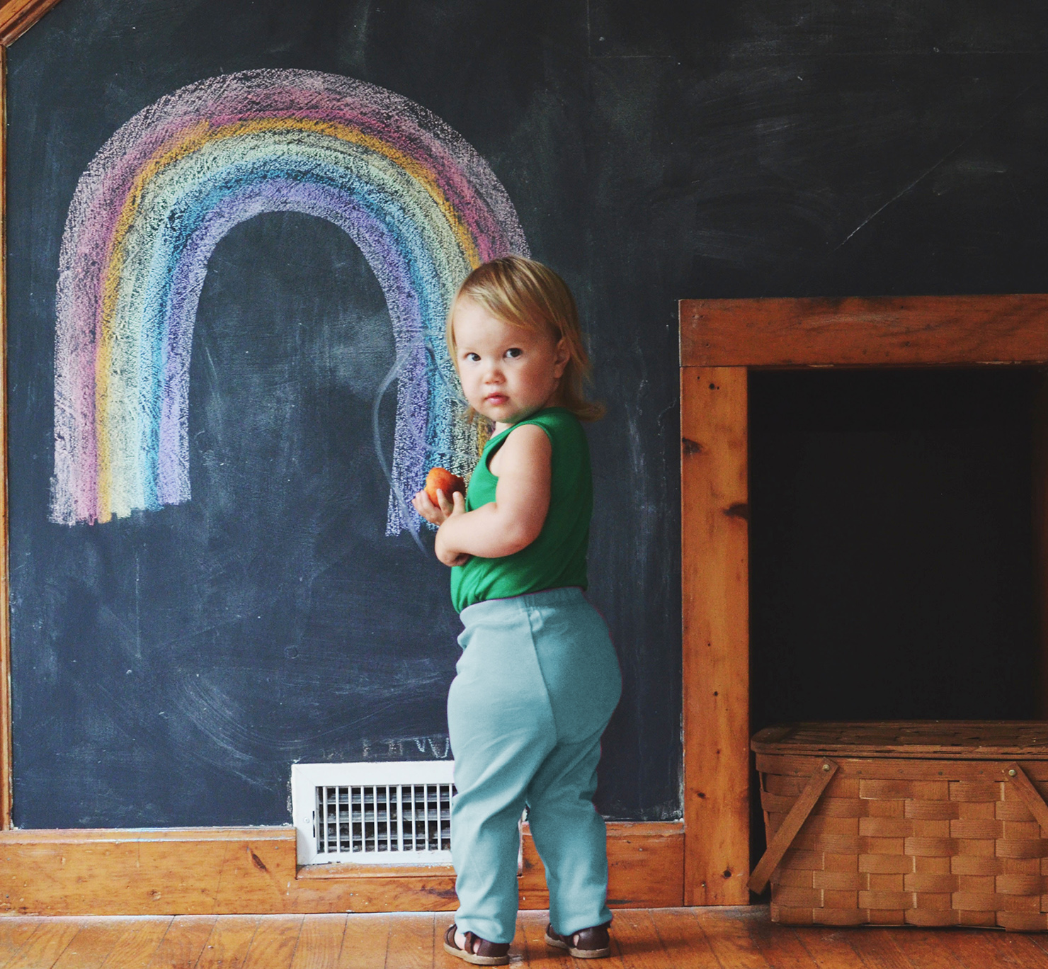 a toddler wearing blue cloth diaper pants from primary.com