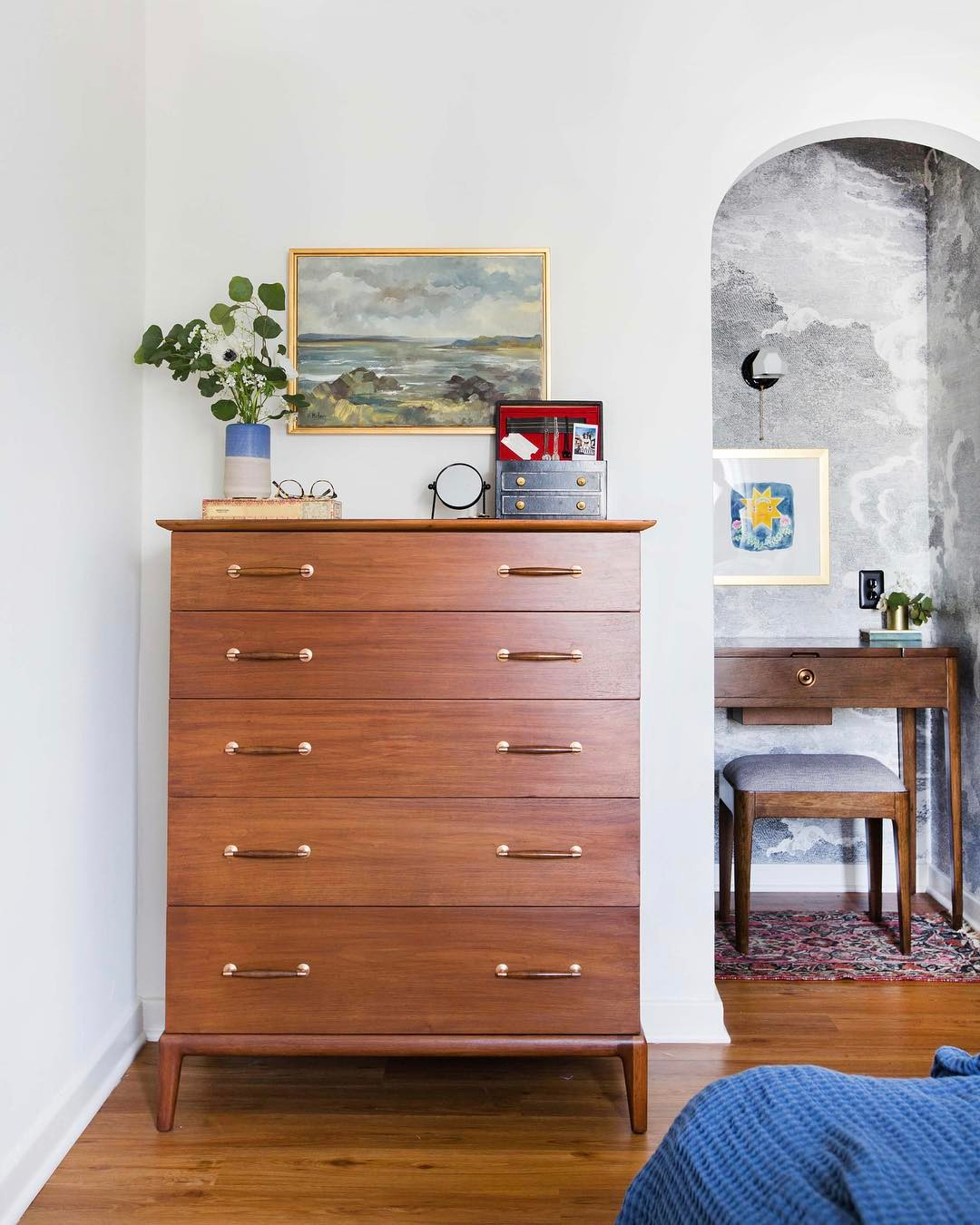 @hellosaratrampinteriors midcentury modern dresser with framed paintings and eucalyptus