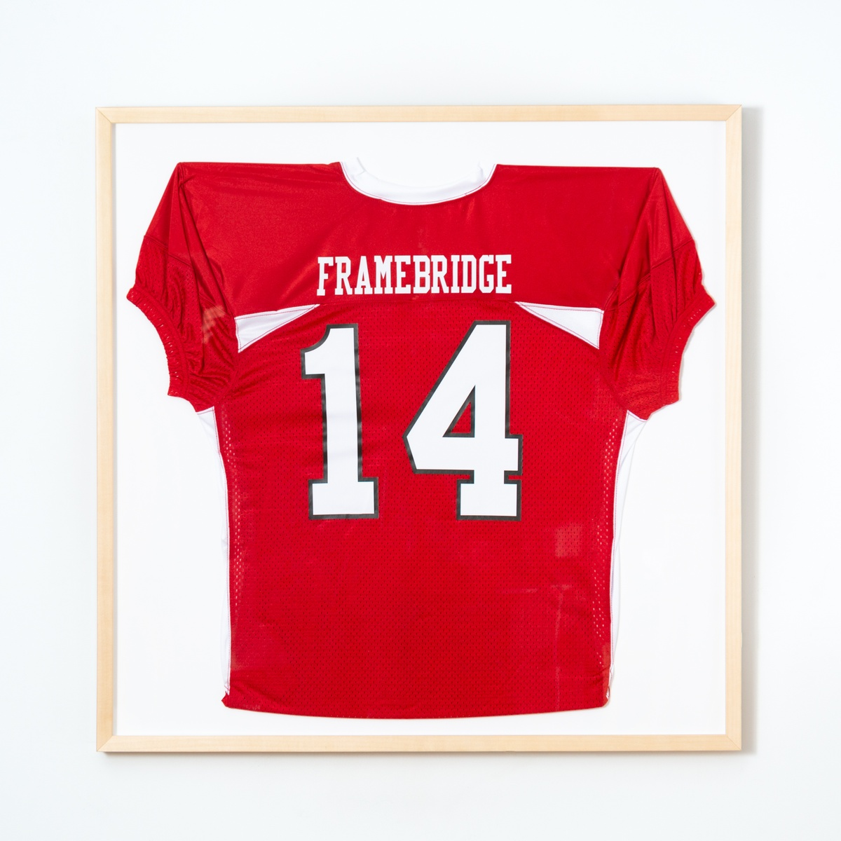 red football jersey in wood frame