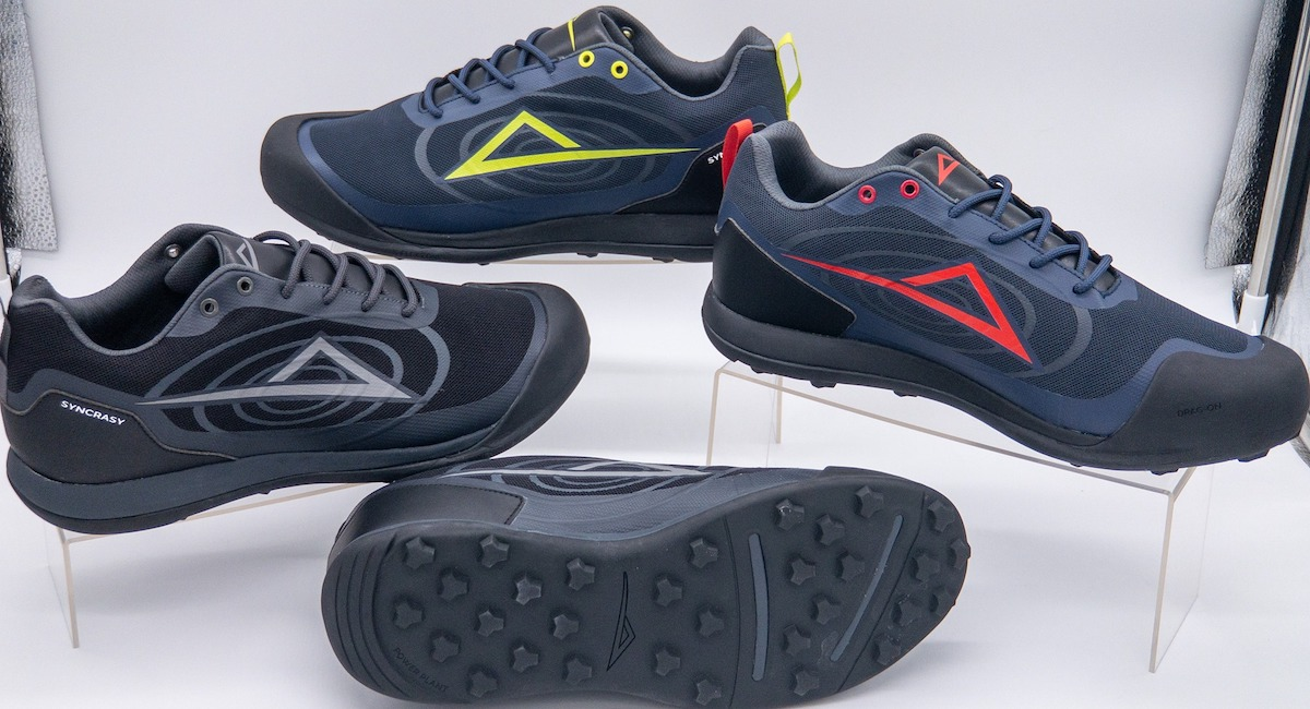 New athletic shoes arranged on display stands with a white background