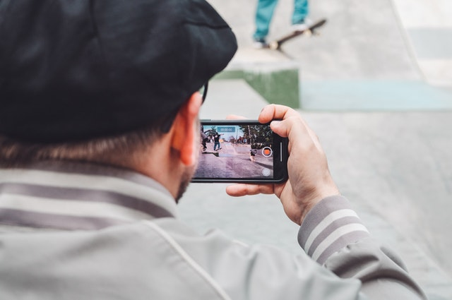 person taking a video in a scavenger hunt