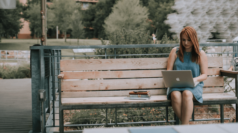 Woman working at laptop in park