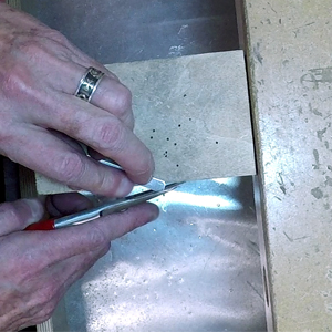 Cutting off the sharp edges on the cuff blank
