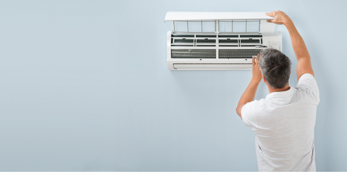 Man Cleaning AC.png