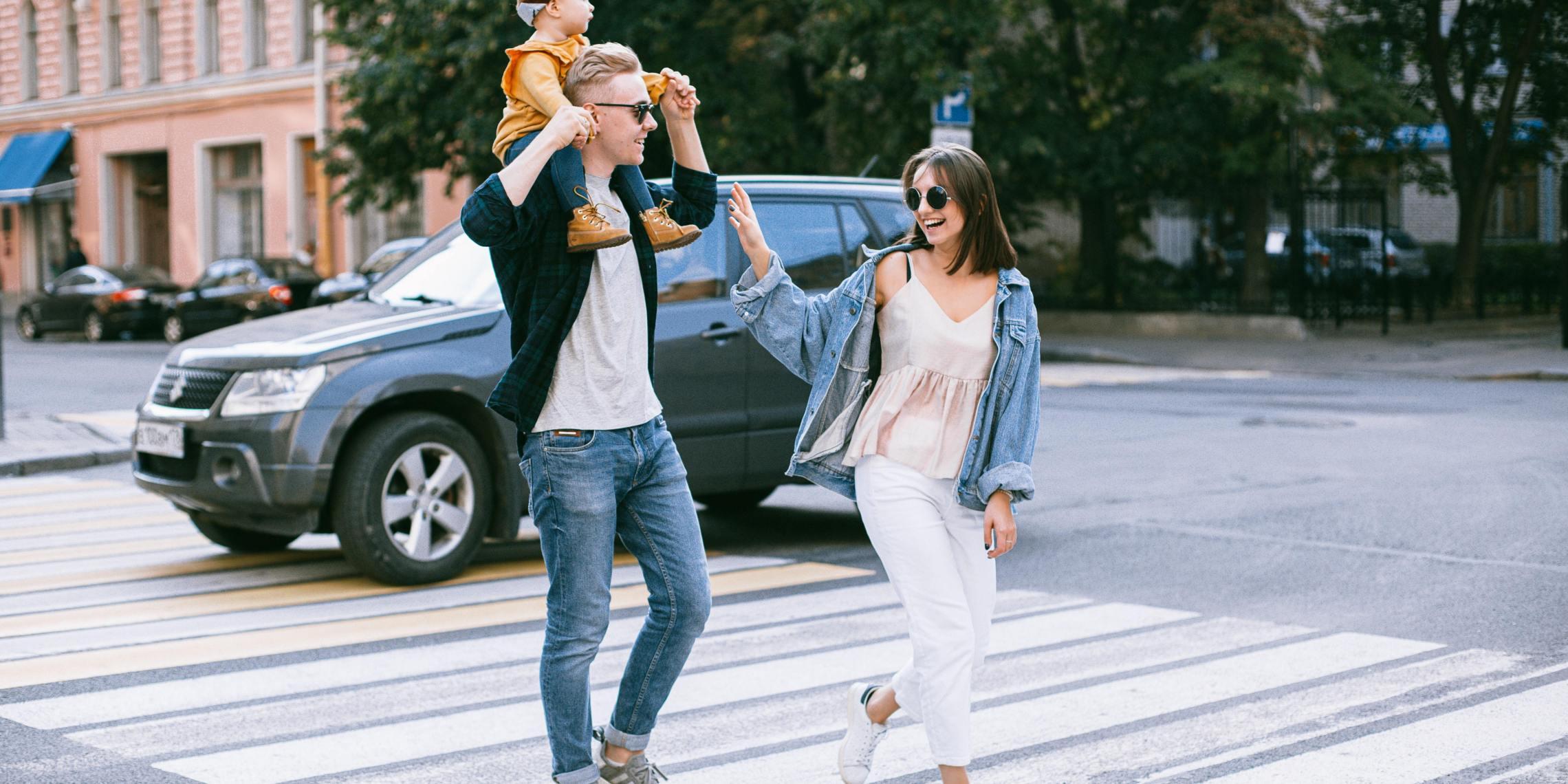 family walking interesting street
