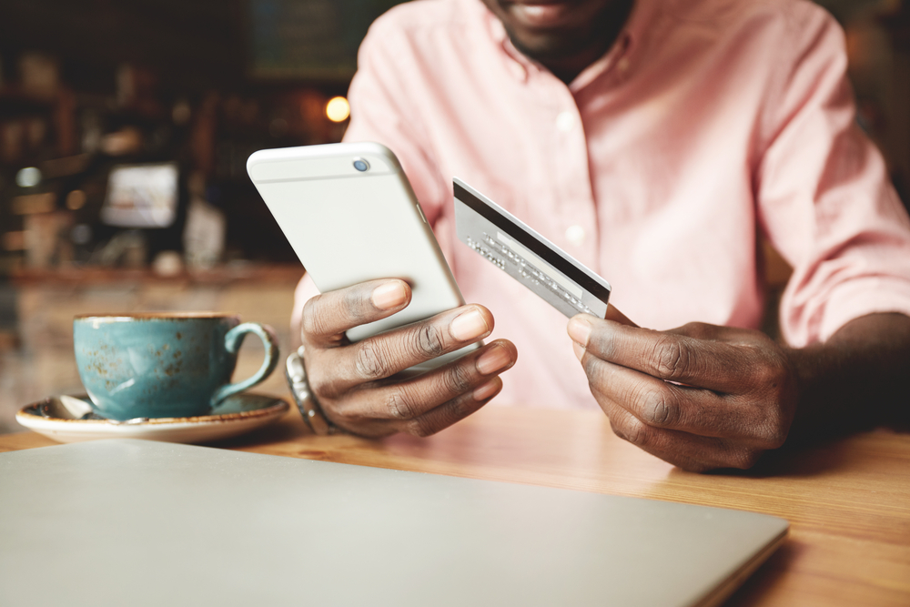man on phone with credit card