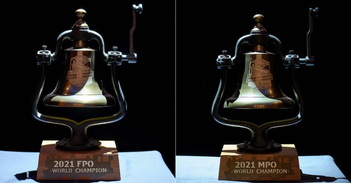Two black bells that are trophies. The bases say 2021 FPO World Champion and 2021 MPO World Champion