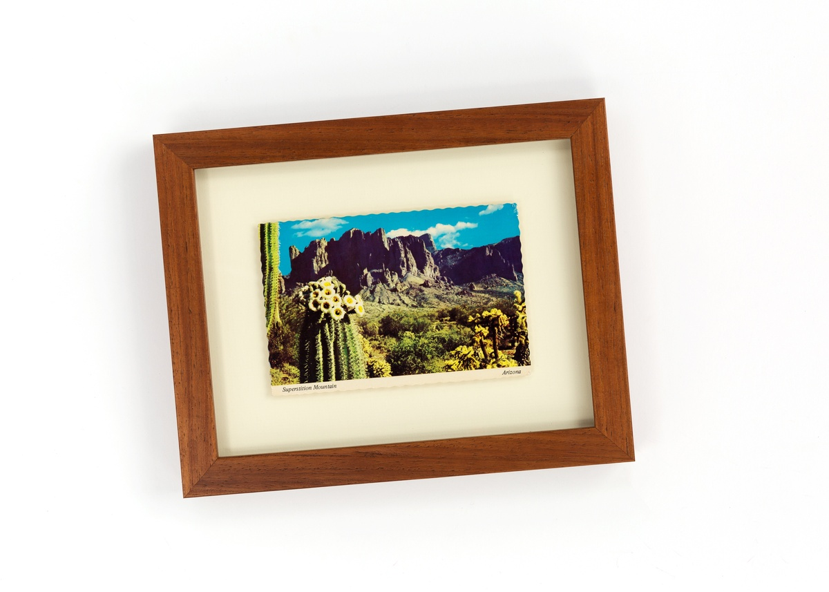 post card in a wood frame