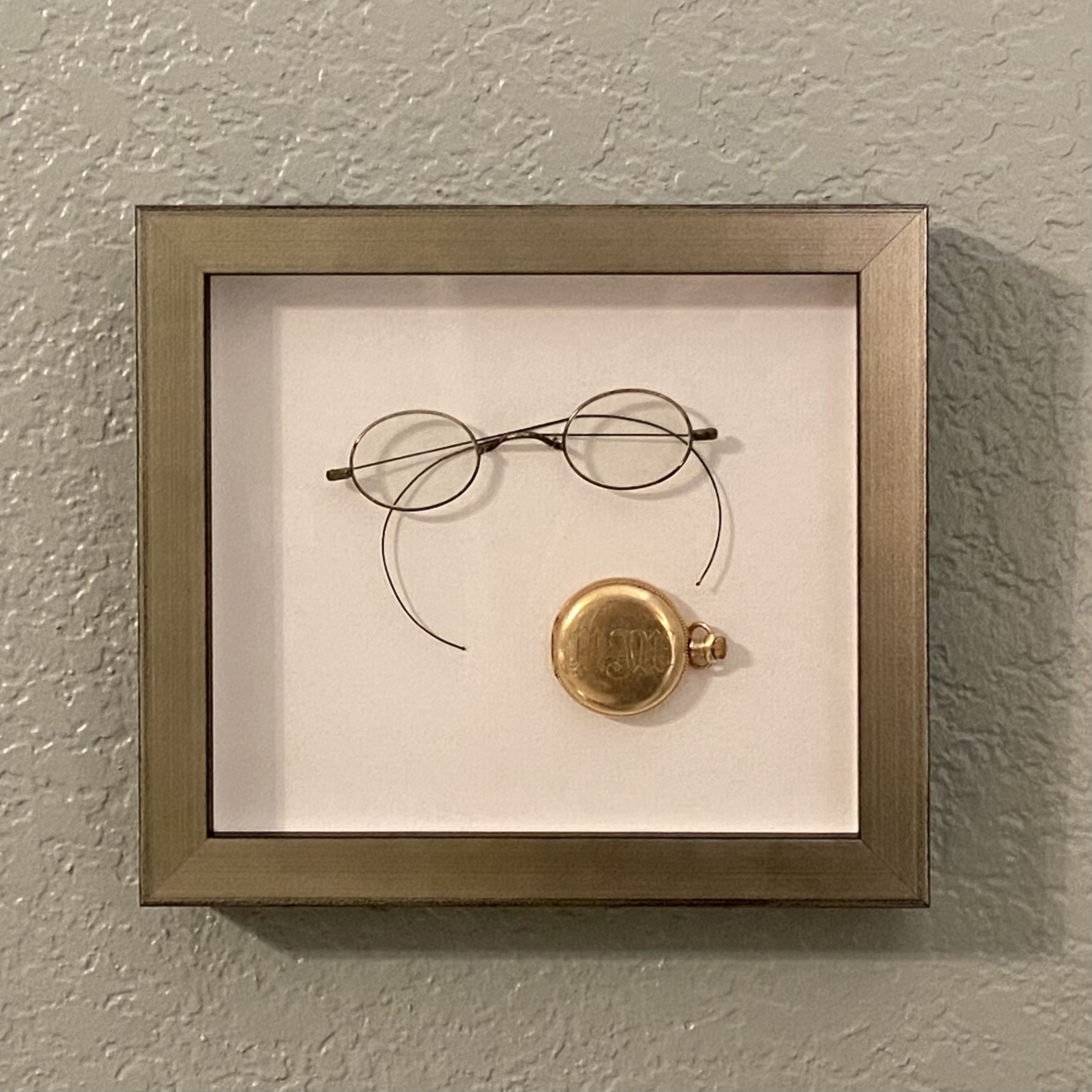 framed glasses and pocketwatch